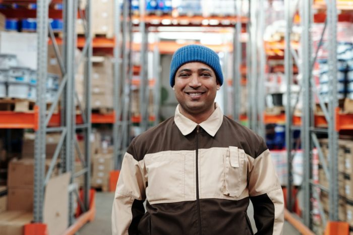 labor day payroll reminder worker smiling