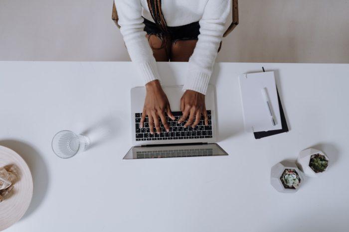 payroll specialist avoiding errors entering payroll on laptop