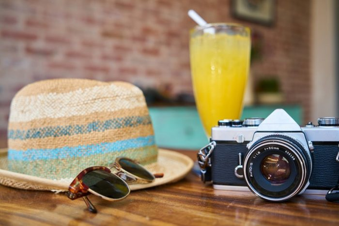 Hat, sunglasses, and camera for employee PTO benefit accruals