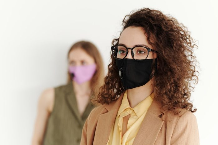 business professional women wearing masks subject to new ca sb 95 sick leave laws