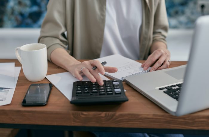 small business owner calculating tax credit amount