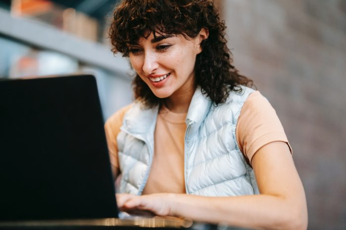 Young woman on laptop enrolling in COBRA with ARPA subsidy
